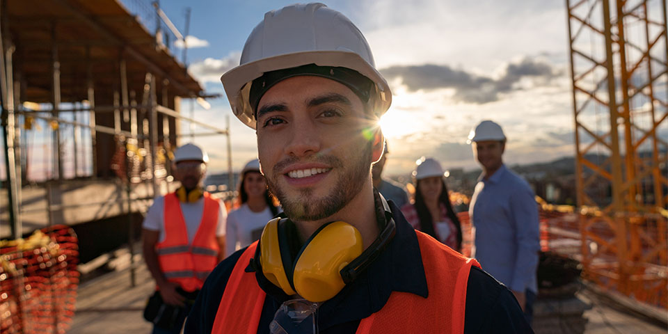 Portrait of a happy construction worker at a building site